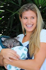 Making waves: Canadian teenager Eugenie Bouchard hugs a local.