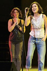 Missy in action … on stage with Sarah McLachlan, Lilith Fair, 2010.