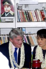 Isolation ends ... Aung San Suu Kyi talks to a visiting British MP, Andrew Mitchell, at an education centre near Rangoon.