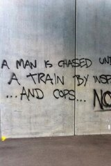Some of the graffiti left at North Melbourne station overnight.