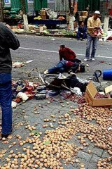 The aftermath of Thursday's bombing at the market in Gongyuan North Street, Urumqi.