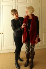 Suzy Black, Personal Shopper and Stylist giving client Carol Turner, 53 a wardrobe make-over in her home. Photo shows Suzy styling Carol in a day time outfit.
