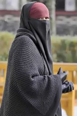 A woman wears the niqab in Lyon, France.