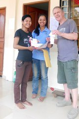 Patrick Arthur with two Cambodian girls he assisted to finish high school and enrol in university.