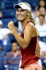 Caroline Wozniacki celebrates her win over Sara Errani.