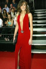 Rebecca Twigley (now married to Chris Judd)  at the 2004 Brownlow medal count at Melbourne Crown Casino wearing 'that' Ruth Tarvydas red dress.