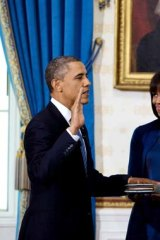 New look ... the attention was on Michelle Obama and her new haircut while Barack Obama took the oath of office on Sunday.