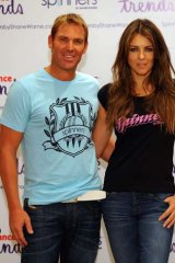 "Australian bowling legend Shane Warne poses with his beau British actress Elizabeth Hurely for the launch of apparel brand ""Spinners by Shane Warne"" in Mumbai."