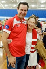 Fan base: Sydney Swans team of the century player Tony Morwood with long-time club fan Philippa Power.