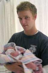 Mathew Hopkins with his new born son Alex.