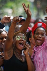 Protesters calling for the impeachment of President Robert Mugabe demonstrate outside the parliament building.