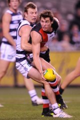 Steve Johnson tackles Lenny Hayes during Friday's game.