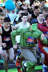Thousands of runners make their way around the circuit, including The Hulk and Iron Man.