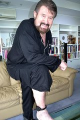 Broadcaster Derryn Hinch shows his ankle bracelet as he prepares to return to the airwaves after a five-month, court-imposed absence.