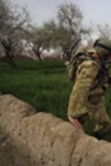 No easy exit: Australian Lance-Corporal Giancarlos Taraborrelli on patrol with Afghan troops in the Baluchi Valley in March.