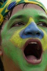 A protester in Rio chants anti-government slogans.