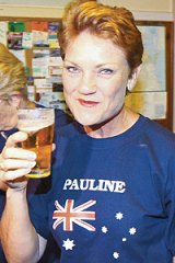 Out of  luck . . . independent Pauline Hanson has a quiet beer last night.