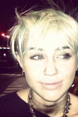 """Cyrus says she feels """"pretty"""" with the 'do."""