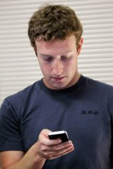 Wrong message ...  Facebook CEO Mark Zuckerberg checks his phone.