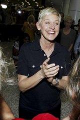 Ellen DeGeneres greets fans on arrival to Sydney.