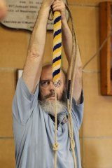 Arm workout: Richard Thomas pulls the bell rope.