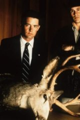 Kyle MacLachlan as FBI Special Agent Dale Cooper and Michael Ontkean as the town's sheriff, Harry S. Truman.