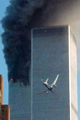A jet airliner flies into one of the World Trade Center towers in New York in 2001.