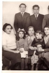 Now and then ... Gawenda's family in Melbourne in the 1950s, with the author sitting on his mother's knee.
