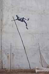 Banksy's pole vaulting stencil.