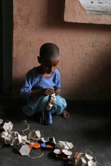 Seven-year-old Shama stitches balls in her village of Rasoolpur Chhodi, in India's Punjab. Shama says she sometimes goes to school, 'but I like stitching'.
