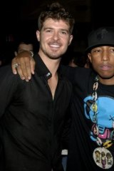 Copy-cats: A jury says singers Pharrell Williams (right) and Robin Thicke copied a Marvin Gaye song to create <i>Blurred Lines</i>.