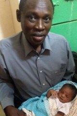 Daniel Wani carrying his newborn daughter Maya at the women's prison before Meriam Ibrahim's release.