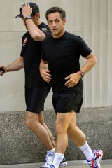 Collapsed while jogging .... French President Nicolas Sarkozy pictured here on a morning run on July 19.