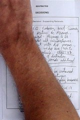 """Stand-off ... the handwritten note by an unidentified British police officer, which outlines that """"Assange to be arrested under all circumstances""""  if he comes out of the embassy."""