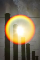 The sun behind stacks of a Latrobe Valley coal plant.