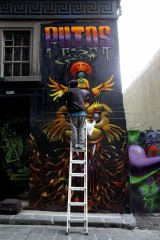 Hosier Lane in Melbourne  gets its latest makeover.  The Age. Photo: Angela Wylie. November 29 2013.