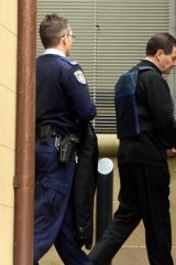 Mark Standen is led away from the NSW Supreme Court after being found guilty of involvement in a drug importation plot.