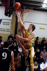 Ben Dowdell fires to the basket in August 2006.