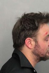 Worse for wear ... Matthew Newton in the police picture taken after his arrest.