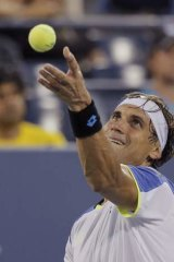 David Ferrer of Spain serves to Nick Kyrgios. Ferrer was too strong for the young Canberran, winning 7-5, 6-3, 6-2.