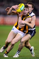 Caught: Joel Selwood tackles Liam Shiels.