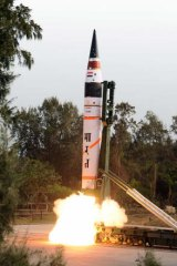 A long-range missile, capable of carrying a one-tonne nuclear warhead is tested in India in 2012.