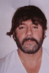 Rug lord: Tony Mokbel was arrested in Greece while wearing this absurd wig.