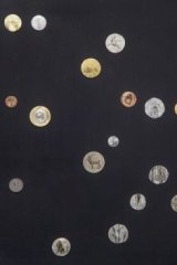 <i>Galaxy</i>, painted coins, by Ni Youyu, of China.