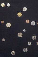 <i>Galaxy</i>, painted coins, by Ni Youyu, of China.