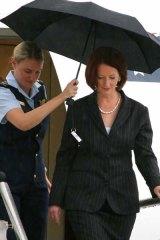 Julia Gillard: sheltering from the storm. <i>Photo: Ben Crabtree</i>