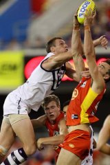 Charlie Dixon of the Suns marks over Jonathon Griffin of the Dockers.