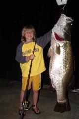 Riley Vallance, 9, with his barramundi.