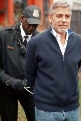 Actor and activist ... a member of the US Secret Service arrests George Clooney.