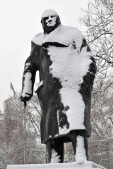 A statue of former British prime minister Winston Churchill is covered in snow in Parliament Square, London.